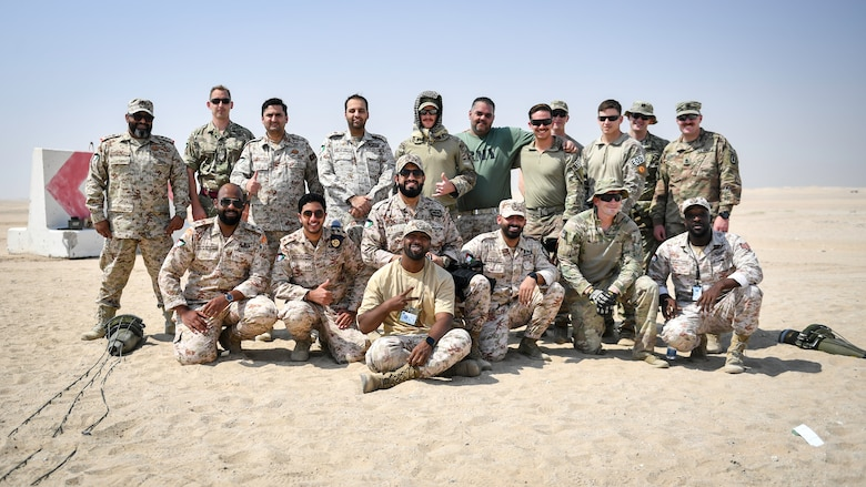 U.S., Kuwaiti and British EOD technicians pose for a group photo at the conclusion of munitions disposal training at the Udari Range, Kuwait, Sept. 30, 2019. The training was designed for U.S. and Kuwaiti forces to share techniques, synchronize capabilities and build partnerships by sharing knowledge and experience.
