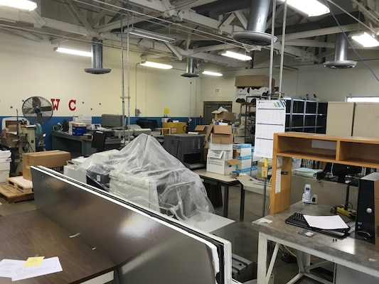 Equipment in the DLA Document Services facility awaits processing before demolition of the facility begins.