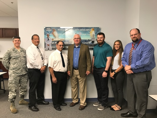 Andrew Steffey, third from right, poses for photo with Mr. Vickers (SES) during his visit to NSWC Crane. Steffey is part of the Pathways Internship Program, which is designed to provide students with opportunities to work and explore Federal careers while still in school. Steffey, who is also currently a senior at USI studying Electrical Engineering, says he was able to put into practice the engineering concepts he is learning at USI.