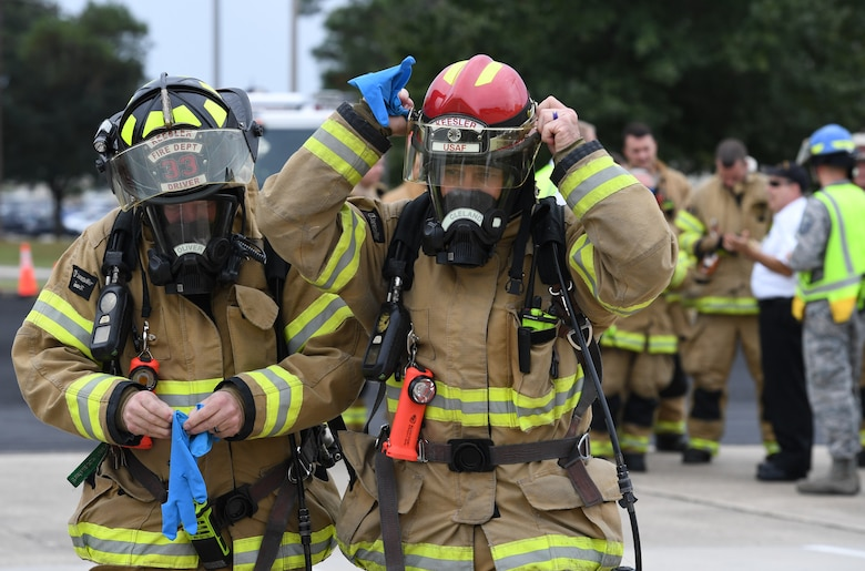 Christopher Oliver and David Cleland, 81st Infrastructure Division firefighters, prepare to make the initial entry into the Live Oak Dining Facility during the Anti-Terrorism, Force Protection Condition and Chemical, Biological, Radiological, Nuclear and high-yield Explosives training exercise at Keesler Air Force Base, Mississippi, Oct. 24, 2019. The exercise scenario simulated a gym bag with ricin found by Keesler personnel who alerted first responders. The exercise was conducted to evaluate the mission readiness and security of Keesler. (U.S. Air Force photo by Kemberly Groue)
