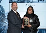 Camellia Cochran, area manager, receives the Best Site award in the large site category for DLA Disposition Services at Columbus from DLA Disposition Services Director Mike Cannon Oct. 24 during the annual leadership summit in Battle Creek, Michigan.