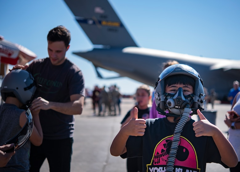 An event goer poses for a picture at the Sheppard Air Force Base Guardians of Freedom Open House and Air Show at Sheppard AFB, Texas, Oct. 27, 2019. The open house and air show is a chance for Sheppard to show and communicate the Air Force's mission as well as Sheppard's specific mission of training, developing and inspiring the next generation of Air Force warriors. (U.S. Air Force photo by Airman 1st Class Pedro Tenorio)