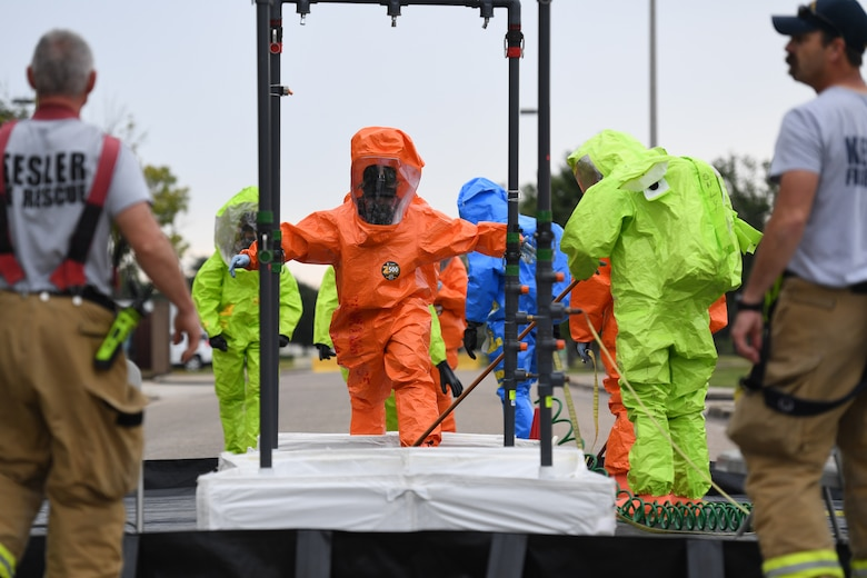 Members of the Keesler fire department, bioenvironmental and emergency management go through the decontamination site during the Anti-Terrorism, Force Protection Condition and Chemical, Biological, Radiological, Nuclear and high-yield Explosives training exercise near the Live Oak Dining Facility at Keesler Air Force Base, Mississippi, Oct. 24, 2019. The exercise scenario simulated a gym bag with ricin found by Keesler personnel who alerted first responders. The exercise was conducted to evaluate the mission readiness and security of Keesler. (U.S. Air Force photo by Kemberly Groue)