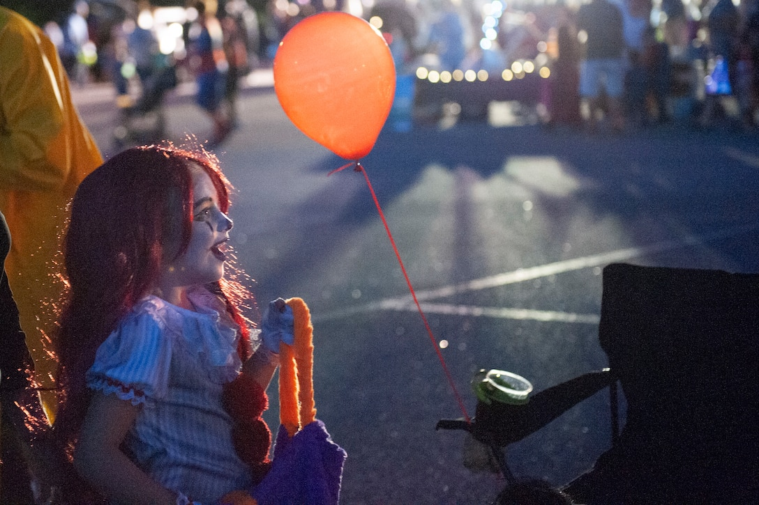 A participant smiles during Trunk or Treat Oct. 25, 2019, at Moody Air Force Base, Ga. Participants, dressed in costumes, received candy from volunteers, who decorated their trunks. (U.S. Air Force photo by Airman 1st Class Jasmine M. Barnes)