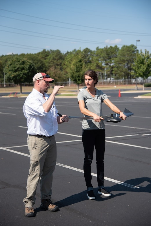 Ryan Strange, left, a research physical scientist with the U.S. Army Corps of Engineers' Aviation and Remote Systems Program and Huntsville Center's Unmanned Aircraft Systems Site Development Branch, gives civil engineer Bethanie Thomas a few final recommendations before she launches the senseFly eBee X fixed-wing unmanned aircraft system into the air outside the U.S. Army Engineering and Support Center, Huntsville, Alabama, Oct. 1, 2019. Thomas is also part of the Unmanned Aircraft Systems Site Development Branch, which is part of Huntsville Center's Engineering Directorate.