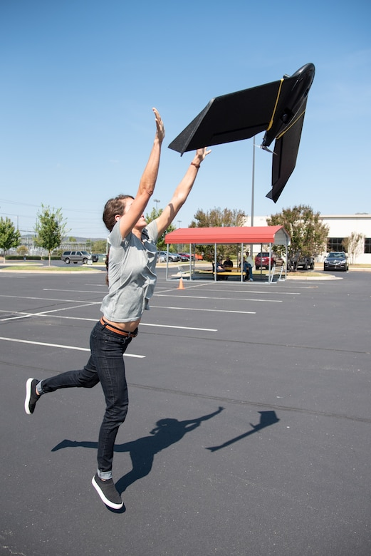 Bethanie Thomas, a civil engineer with Huntsville Center's Unmanned Aircraft Systems Site Development Branch, launches the senseFly eBee X fixed-wing unmanned aircraft system into the air outside the U.S. Army Engineering and Support Center, Huntsville, Alabama, Oct. 1, 2019.