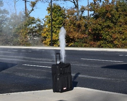The exercise biological dispersal device, developed by Air Force Office of Special Investigations Special Agents Randy Flinchbaugh and Zeth Lackey of the 2nd Field Investigations Squadron, Joint Base Andrews, Md., detonates at the JBA Main Gate Oct. 23, 2019. (AFOSI photo)
