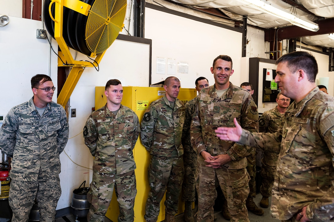 Col. Dan Walls, right, 23d Wing commander, speaks to Airman 1st Class Tyler Quattlebaum, far left, 23d Maintenance Squadron (MXS) munitions support equipment maintenance technician, during an immersion tour Oct. 28, 2019, at Moody Air Force Base, Ga. Walls toured the 23d MXS munitions flight facilities, where the Airmen showcased their squadron and mission. This gave Walls the opportunity to see how 23d MXS improves deployability and ensures mission readiness. (U.S. Air Force photo by Senior Airman Erick Requadt)