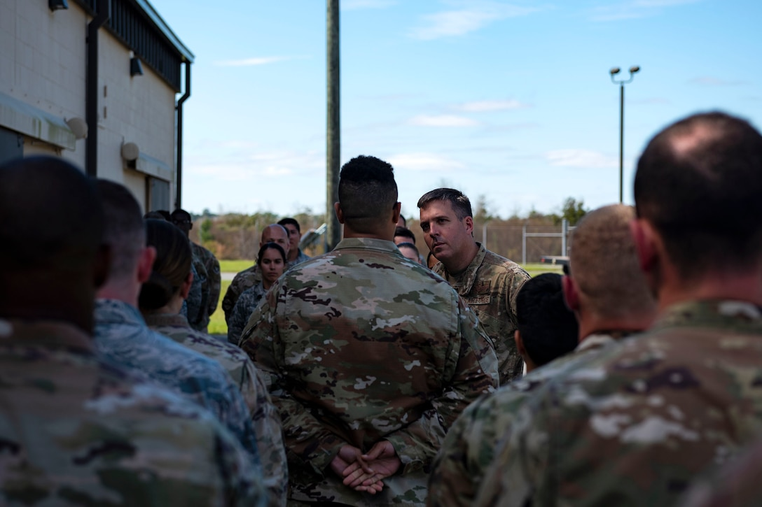 Col. Dan Walls, center, 23d Wing commander, talks with Airmen assigned to the 23d Maintenance Squadron (MXS) during an immersion tour Oct. 28, 2019, at Moody Air Force Base, Ga. Walls toured the 23d MXS munitions flight facilities, where the Airmen showcased their squadron and mission. This gave Walls the opportunity to see how 23d MXS improves deployability and ensures mission readiness. (U.S. Air Force photo by Senior Airman Erick Requadt)