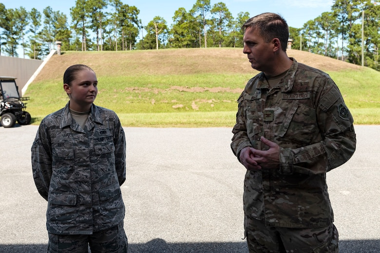 Col. Dan Walls, right, 23d Wing commander, speaks to Airman 1st Class Lindlie Rabe, 23d Maintenance Squadron (MXS) stockpile management technician, during an immersion tour Oct. 28, 2019, at Moody Air Force Base, Ga. Walls toured the 23d MXS munitions flight facilities, where the Airmen showcased their squadron and mission. This gave Walls the opportunity to see how 23d MXS improves deployability and ensures mission readiness. (U.S. Air Force photo by Senior Airman Erick Requadt)