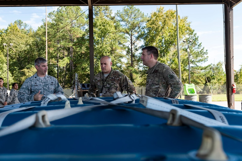 Col. Dan Walls, right, 23d Wing commander, speaks to 23d Maintenance Squadron (MXS) leadership during an immersion tour Oct. 28, 2019, at Moody Air Force Base, Ga. Walls toured the 23d MXS munitions flight facilities, where the Airmen showcased their squadron and mission. This gave Walls the opportunity to see how 23d MXS improves deployability and ensures mission readiness. (U.S. Air Force photo by Senior Airman Erick Requadt)