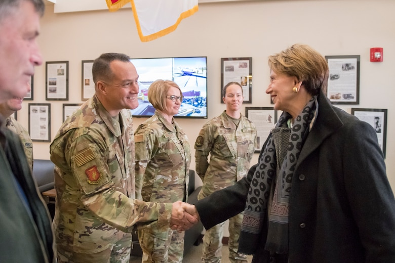 U.S. Air Force Chief Master Sgt. Joshua Moore, state command chief, Wyoming National Guard, greets Secretary of the Air Force Barbara Barrett at the 153d Airlift Wing, Wyoming Air National Guard Base, Cheyenne, Wyo., Oct. 27, 2019. This visit marks Barrett's first official visit since becoming the SECAF.