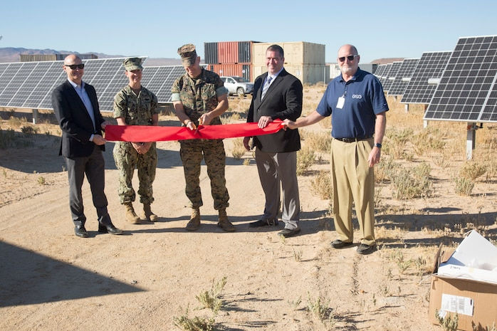 (Left) David Base, Energy Systems Group; Lt. Cmdr. Jamie Rivas, Public Works Officer, MCLB Barstow; Steven Smith, vice president, ESG; and David Koch ESG; join Col. Craig Clemans, commanding officer, MCLBB; as he officially opens a ten acre solar farm aboard the Yermo Annex of Marine Corps Logistics Base Barstow, Calif., Oct. 22.