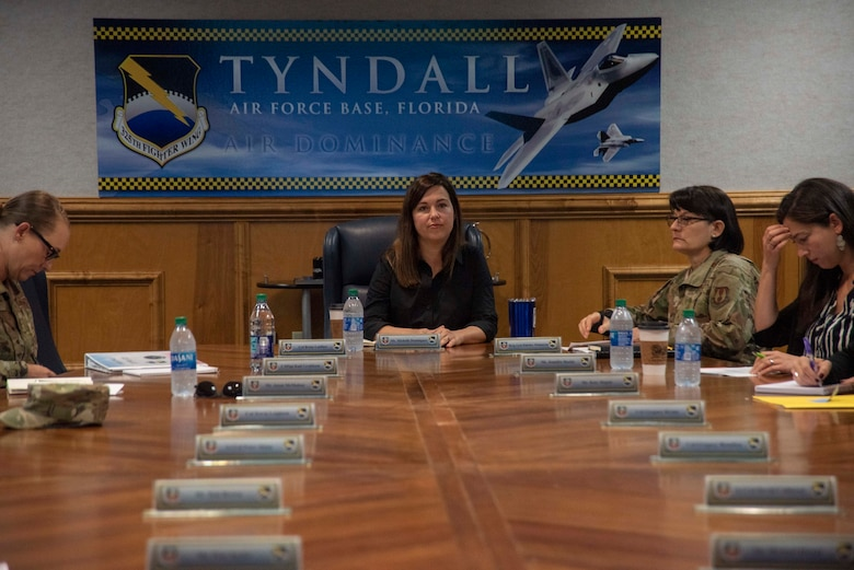 Michelle Dominguez, Clerk, Senate Appropriations Committee-M, attends a 325th Fighter Wing Hurricane Michael recovery and rebuild update briefing on Oct. 28, 2019, at Tyndall Air Force Base, Florida. Dominguez, along with other professional staff members, received a briefing from Col. Brian Laidlaw, 325th FW commander, regarding the progress Tyndall had made since the devastation caused from Hurricane Michael in 2018. Laidlaw said the base is back to having 90 percent of the missions, conducted by 80 percent of the personnel, utilizing 50 percent of the facilities. (U.S. Air Force photo by Staff Sgt. Magen M. Reeves)