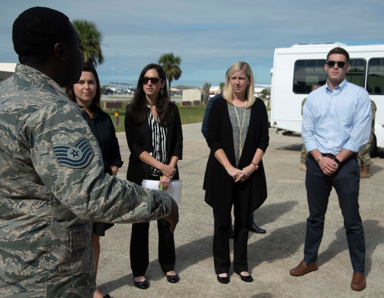 Tech. Sgt. Donte Slocum, 325th Maintenance Squadron F-22 Hangar 4 technician, briefs several members of the Senate Appropriations Committee on Oct. 28, 2019, at Tyndall Air Force Base, Florida. The attendees viewed an aircraft undergoing maintenance and saw one of the few structures to survive Hurricane Michael which devastated the base in 2018. Other than losing its roof, the hangar was completely untouched on the inside, saving the harbored aircraft during the storm. (U.S. Air Force photo by Staff Sgt. Magen M. Reeves)