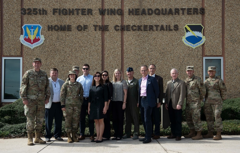 Members of the Senate Appropriations Committee, military members, and civilian partners, pose for a photo on Oct. 28, 2019, at Tyndall Air Force Base, Florida. The professional staff members toured the base with Col. Brian Laidlaw, 325th Fighter Wing commander and his leadership team, to see the progress Tyndall had made since the devastation caused from Hurricane Michael in 2018. Laidlaw said the base is back to having 90 percent of the missions, conducted by 80 percent of the personnel, utilizing 50 percent of the facilities. (U.S. Air Force photo by Staff Sgt. Magen M. Reeves)