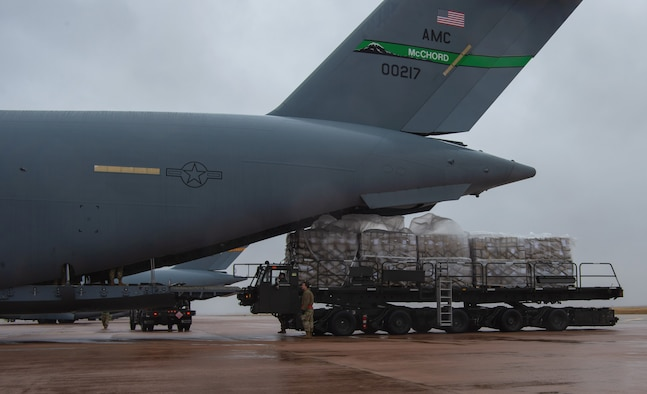 Airmen assigned to the 8th Airlift Squadron (AS), prepare to load pallets of rice onto a C-17 Globemaster III assigned to the 62nd Airlift Wing, Joint Base Lewis-McChord, Wash., at Altus Air Force Base, Okla., Oct. 24, 2019. The rice was delivered to Honduras, which will be used to feed more than 500,000 Honduran men, women and children over the next six weeks. (U.S. Air Force photo by Senior Airman Tryphena Mayhugh)