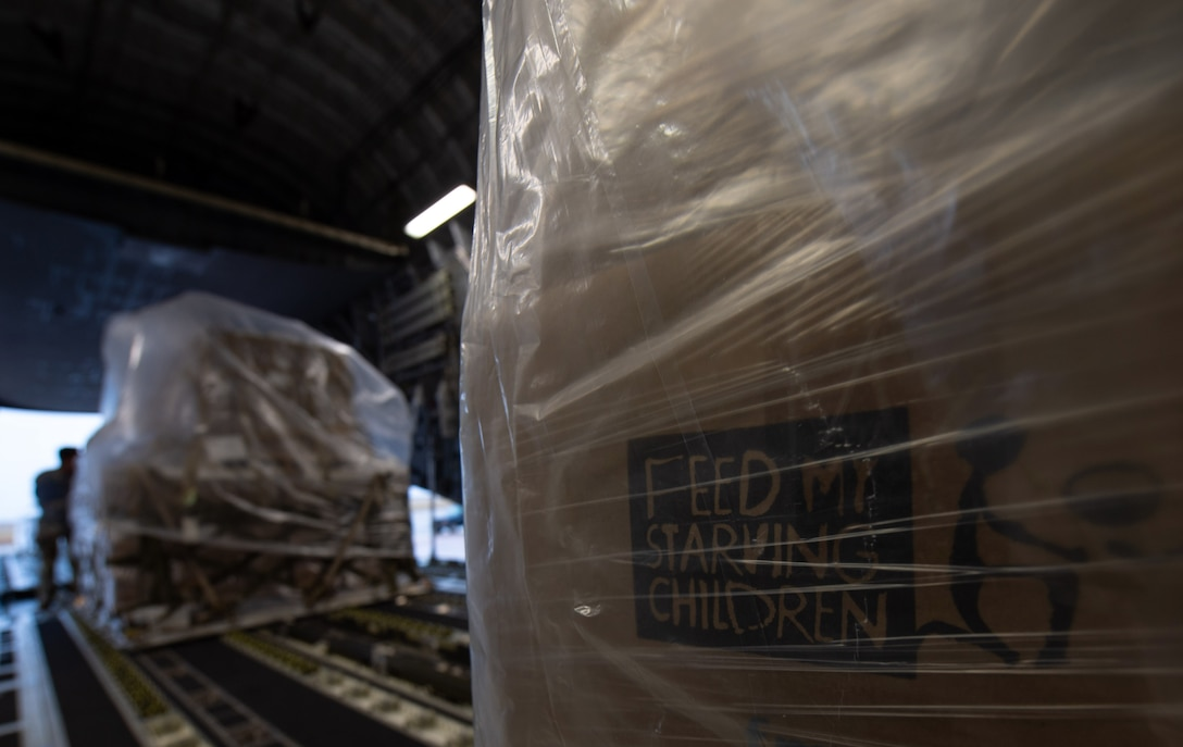 Airmen assigned to the 8th Airlift Squadron push a pallet of rice onto a C-17 Globemaster III assigned to the 62nd Airlift Wing, Joint Base Lewis-McChord, Wash., at Altus Air Force Base, Okla., Oct. 24, 2019. The rice was delivered to Honduras to feed more than 500,000 malnourished Honduran men, women and children. (U.S Air Force photo by Senior Airman Tryphena Mayhugh)