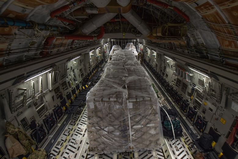 Pallets containing more than 83,000 pounds of rice sit inside a C-17 Globemaster III assigned to the 62nd Airlift Wing, Joint Base Lewis-McChord, Wash., at Altus Air Force Base, Okla., Oct. 24, 2019. The rice was delivered to Honduras during a humanitarian mission to provide food for orphanages, schools and feeding programs for children and families. (U.S Air Force photo by Senior Airman Tryphena Mayhugh)