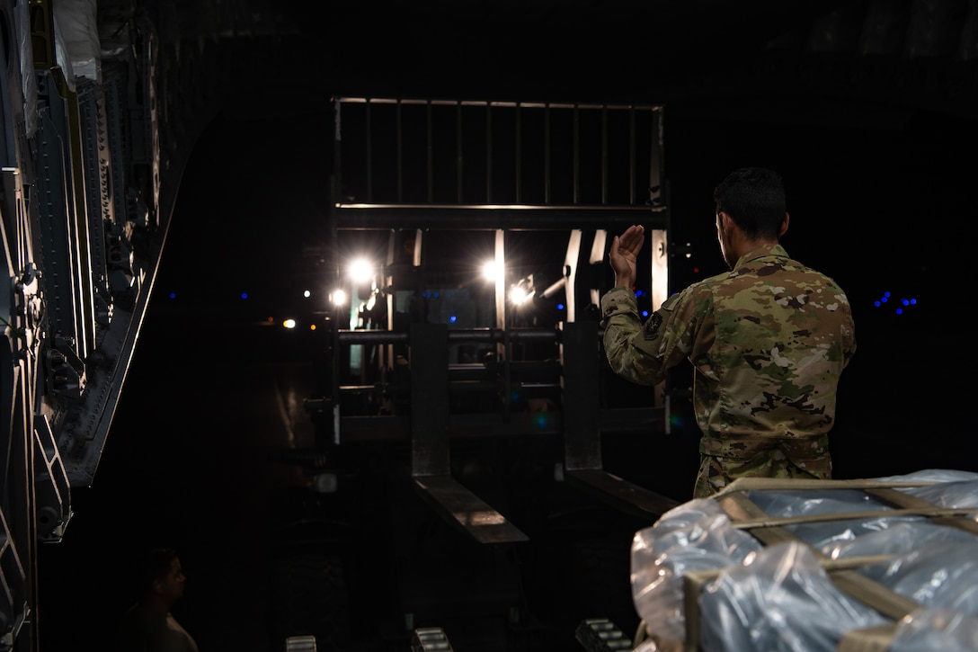 U.S. Air Force Staff Sgt. Marcello Moffat, 8th Airlift Squadron (AS) loadmaster, marshals a forklift toward a C-17 Globemaster III assigned to the 62nd Airlift Wing, Joint Base Lewis-McChord, Wash., at Soto Cano Air Base, Honduras, Oct. 24, 2019. Moffat, along with other 8th AS Airmen, helped deliver more than 83,000 pounds of rice to Honduras during a humanitarian mission. (U.S Air Force photo by Senior Airman Tryphena Mayhugh)