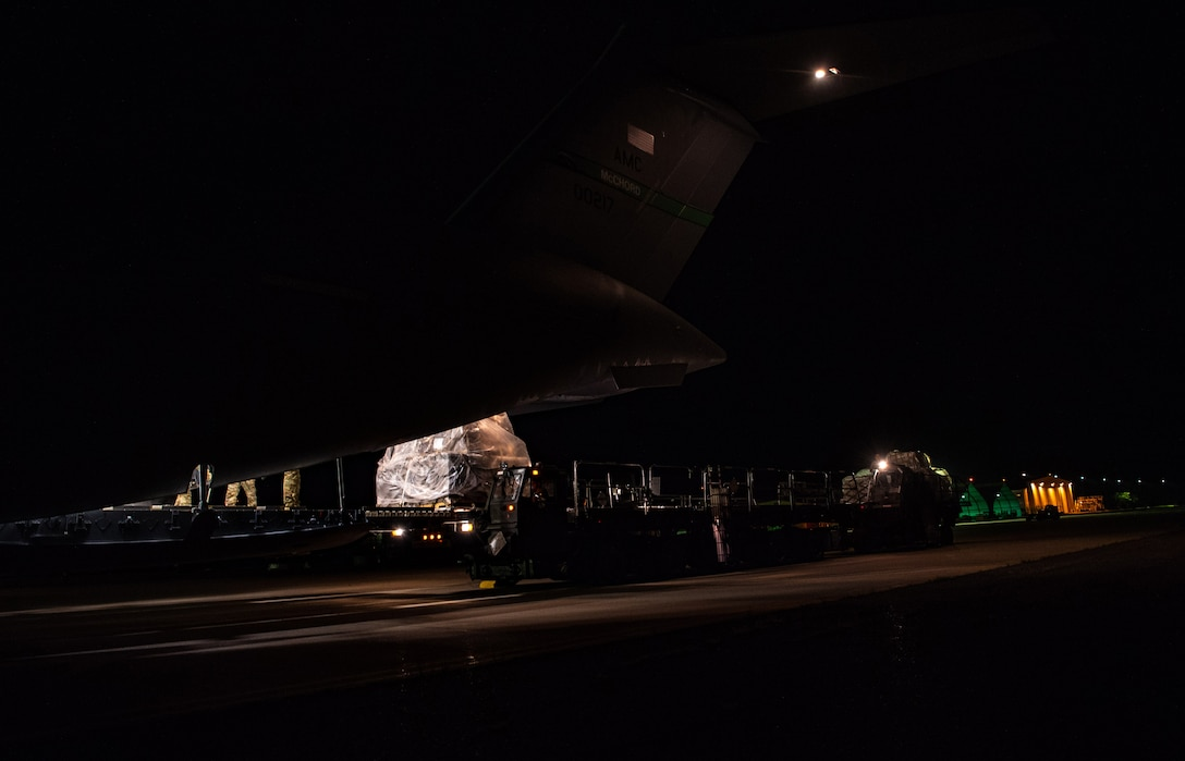 A pallet of rice exits a C-17 Globemaster III assigned to the 62nd Airlift Wing, Joint Base Lewis-McChord, Wash., at Soto Cano Air Base, Honduras, Oct. 24, 2019.  More than 83,000 pounds of rice was donated to the people of Honduras, as 48 percent of the population in rural areas is malnourished, with 35 percent overall. (U.S Air Force photo by Senior Airman Tryphena Mayhugh)