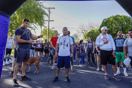 Marines and base patrons are warmed up and ready to start the 6th annual 5K Survivor Walk aboard Marine Corps Logistics Base Barstow, Calif., Oct. 23. (U.S. Marine Corps photo by Jack J. Adamyk)