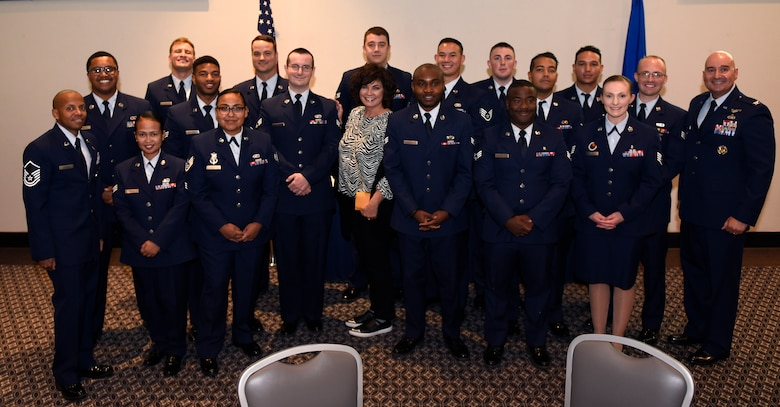 Class 19-G poses for a group photo with their cadre and, the sister of Medal of Honor recipient Capt. Lance P. Sijan, Janine Sijan, at the event center on Goodfellow Air Force Base, Texas, Oct. 24, 2019. Class 19-G told Sijan's story and held a moment of silence in his honor. (U.S. Air Force photo by Airman 1st Class Ethan Sherwood/Released)