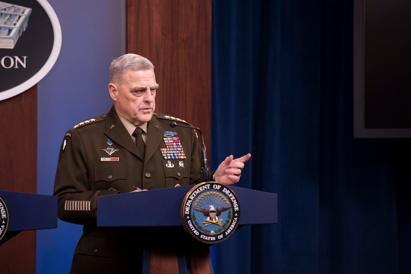 Four-star Army general answers a question while standing at a lectern bearing the Department of Defense emblem.