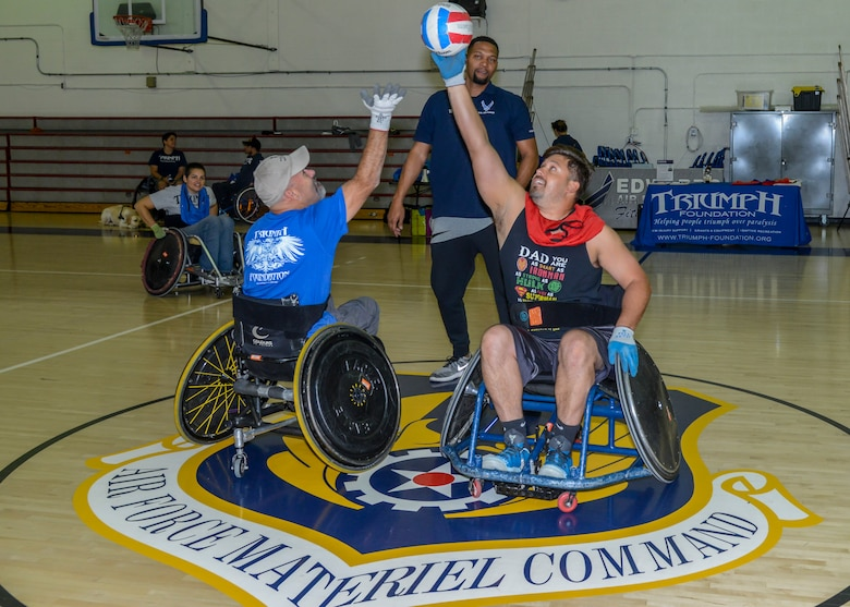 A wheelchair rugby game tips off at the base gym on Edwards Air Force Base, California, Oct. 24. The wheelchair rrugby, or murderball, demonstration was headed by the Triumph Foundation, a non-profit organization, in support of the base's observance of National Disability Employment Awareness Month. (U.S. Air Force photo by Giancarlo Casem)