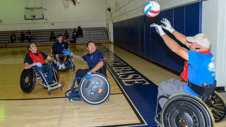 A player throws a ball back into play during a Murderball wheelchair rugby demonstration at Edwards Air Force Base, Oct. 24. The demonstration was headed by the Triumph Foundation, a non-profit organization, in support of the base's observance of National Disability Employment Awareness Month. (U.S. Air Force photo by Giancarlo Casem)
