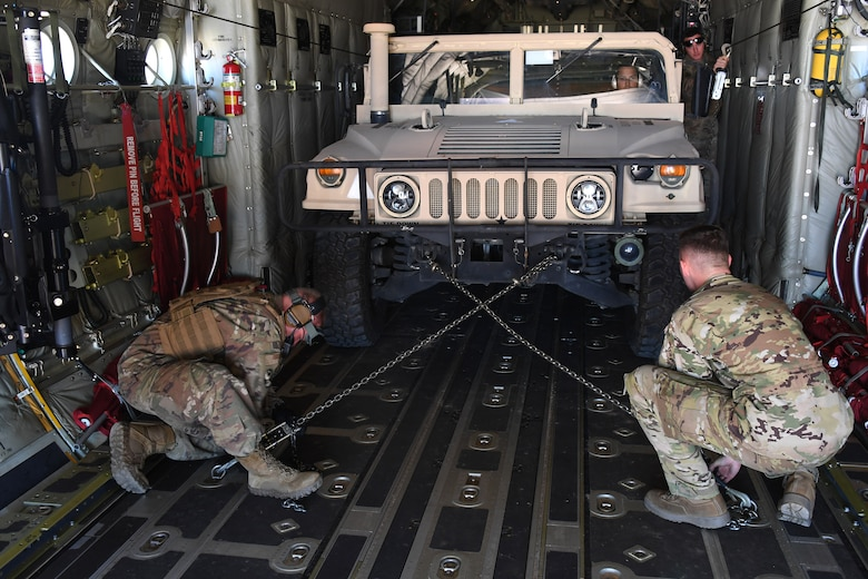 U.S. Air Force Airmen secure a Humvee onto a C-130 Hercules aircraft at the Geronimo Landing Zone during exercise Green Flag Little Rock, Oct. 23, 2019, Fort Polk, Louisiana. During the exercise the team loaded and downloaded tactical vehicles, airdrop bundles, along with a variety of other pallets to support the Army. (U.S. Air Force photo by Tech. Sgt. Liliana Moreno)