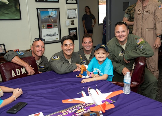 """Corpus Christi, Texas Driscoll Children's Hospital patient, and Naval Air Station Corpus Christi Pilot for a Day Alessandra """"Ale"""" Alaniz poses for a """"hero"""" shot with her new Laughlin Air Force Base, Texas, aviation teammates (left to right) Lt. Col. Doug Hayes, 96th Flying Training Squadron; Capt. Roland Kern, 86th Flying Training Squadron; Capt. Anthony Giebelhaus, 86th FTS, and Maj. Wade Dahlgren, 96th FTS.  Ale is the 100th child selected for the NAS Corpus Christi program. (U.S. Air Force photo)"""
