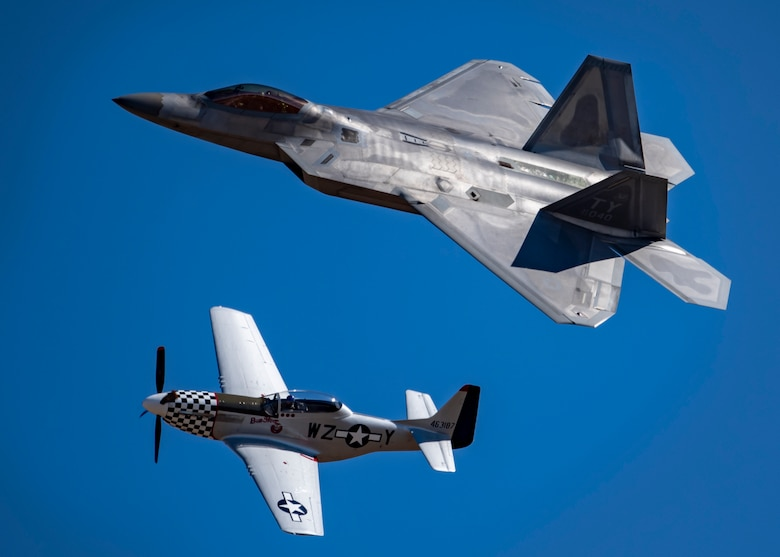 A F-22 Raptor flies alongside a P-51 Mustang during the Sheppard Air Force Base Open House and Air Show at Sheppard AFB, Texas, Oct. 28, 2019. The Air Force Heritage Flight Foundation celebrates U.S. air power history and serves as a living memorial to those who have served in the U.S. Air Force by providing 40-60 annual Heritage Flight demonstrations around the world. (U.S. Air Force photo by Airman 1st Class Pedro Tenorio)