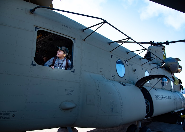 An event goer looks out of a CH-47 Chinook at the Sheppard Air Force Base Guardians of Freedom Open House and Air Show at Sheppard AFB, Texas, Oct. 27, 2019. The open house and air show was a opportunity for the local community to come and see some of the inner workings of Sheppard AFB. It also allowed Sheppard to educate the community on it's mission and the Air Force's role in defending freedom. There were also multiple recruiters to help educate the spectators as well. (U.S. Air Force photo by Airman 1st Class Pedro Tenorio)