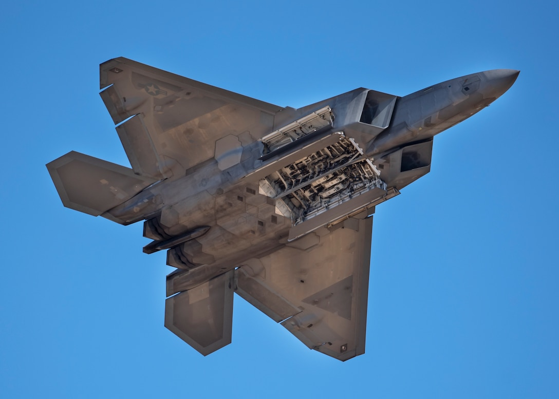 Maj. Paul Lopez II flies an F-22 Raptor during the Sheppard Air Force Base Guardians of Freedom Open House and Air Show at Sheppard AFB, Texas, Oct. 26, 2019. Lopez is the F-22 demonstration team commander. The F-22 Raptor demonstration team performs precision aerial maneuvers at air shows across the world to demonstrate the unique capabilities of the world's premier fifth generation fighter aircraft. (U.S. Air Force photo by Airman 1st Class Pedro Tenorio)
