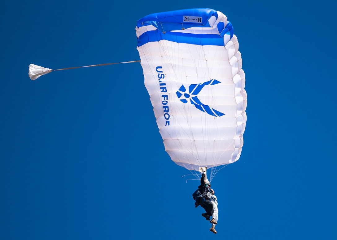 A U.S. Air Force Academy Wings of Blue parachute team member and Chief Master Sgt. Diena Mosely, 82nd Training Wing command chief, glide in a parachute during the Sheppard Air Force Base Guardians of Freedom Open House and Air Show at Sheppard AFB, Texas, Oct. 28, 2019. The Wings of Blue demonstration team travels across the country to air shows, sporting events and other venues to represent the Air Force in precision parachuting. Other than traveling, their primary mission is to run the Air Force's Basic Freefall Parachuting course, known as Airmanship 490. (U.S. Air Force photo by Airman 1st Class Pedro Tenorio)