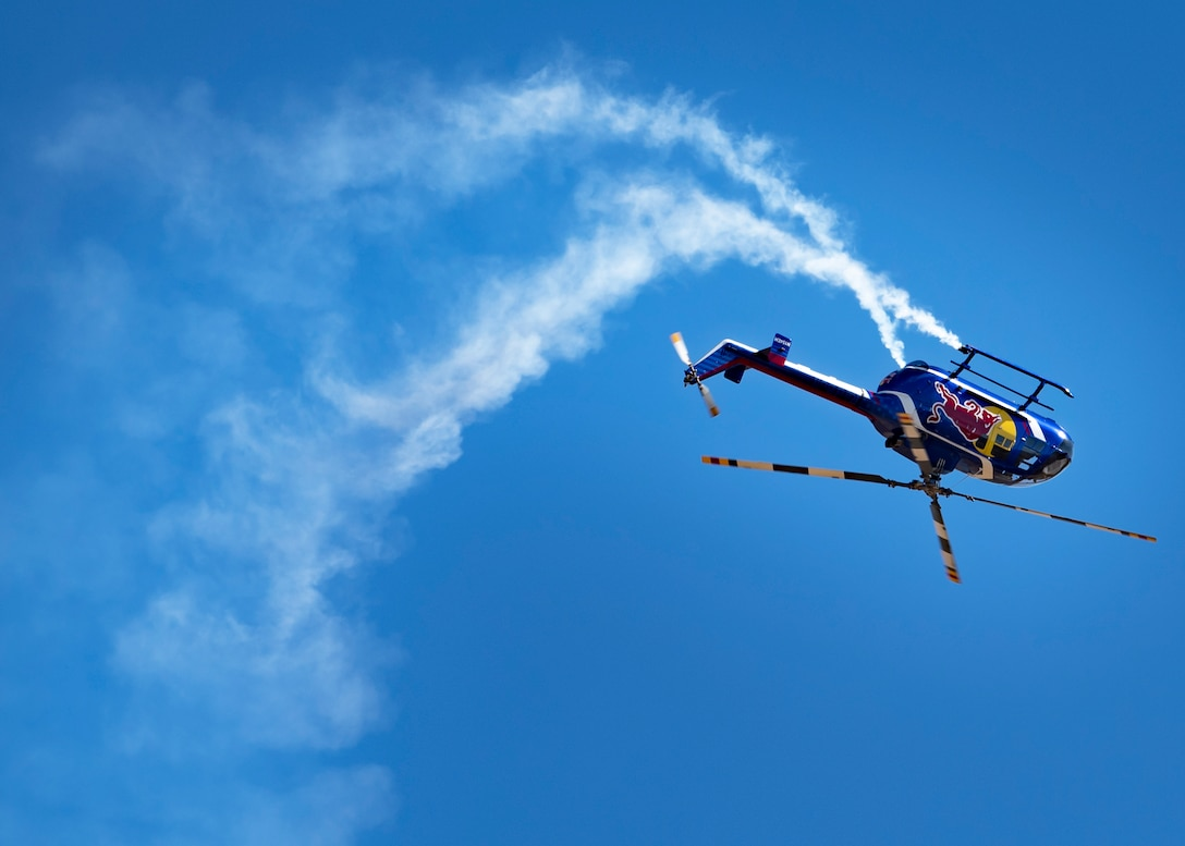 The Red Bull Air Force helicopter does a flip while performing at the Sheppard Air Force Base Guardians of Freedom Open House and Air Show at Sheppard AFB, Texas, Oct. 26, 2019. The Red Bull Air Force is a team assembled from accomplished and experienced aviation experts in the whole world. They specialize in highly coordinated aerial jump demonstrations and continually push the limits of human flight. They do base jumping, wingsuits, free flying, speed riding and more. (U.S. Air Force photo by Airman 1st Class Pedro Tenorio)