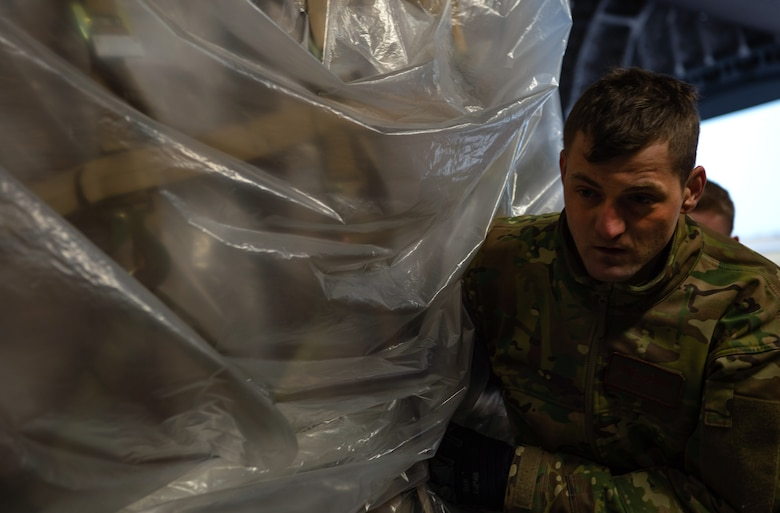 U.S. Air Force Staff Sgt. Garrett Sicafoose, 8th Airlift Squadron loadmaster, pushes a pallet of rice onto a C-17 Globemaster III assigned to the 62nd Airlift Wing, Joint Base Lewis-McChord, Wash., at Coronel Enrique Soto Cano Air Base, Honduras, Oct. 24, 2019. The rice was donated to Honduras as, due to extreme poverty and natural disasters, more than 48 percent of the population in rural areas are malnourished, with 35 percent overall. (U.S Air Force photo by Senior Airman Tryphena Mayhugh)
