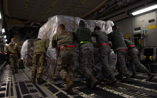 Airmen assigned to the 62nd Airlift Wing (AW) and 97th Air Mobility Wing load pallets of rice onto a C-17 Globemaster III assigned to the 62nd AW, Joint Base Lewis-McChord, Wash., at Altus Air Force Base, Okla., Oct. 24, 2019. More than 83,000 pounds of rice was delivered to Honduras by Airmen assigned to the 8th Airlift Squadron, Joint Base Lewis-McChord, Wash., for a humanitarian mission. (U.S Air Force photo by Senior Airman Tryphena Mayhugh)