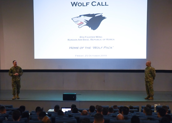 U.S. Air Force Col. Tad Clark, 8th Fighter Wing commander and Chief Master Sgt. Steve Cenov, 8th FW command chief, host their second commander's call for the members of the Wolf Pack at Kunsan Air Base, Republic of Korea, Oct. 25, 2019. The commander's call gave base leaders the opportunity to elaborate on multi-domain operations, squadron empowerment, multi-functional Airmen, agile combat employment, readiness and innovation. (U.S. Air Force photo by Staff Sgt. Anthony Hetlage)