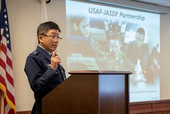 Japanese Air Self-Defense Force Maj. Gen. Shinya Bekku, JASDF Surgeon General, address a room full of Headquarters Pacific Air Forces and the 374th Medical Group leadership about the ongoing partnership between the two nation's medical teams at Yokota Air Base, Japan, Oct. 28, 2019.