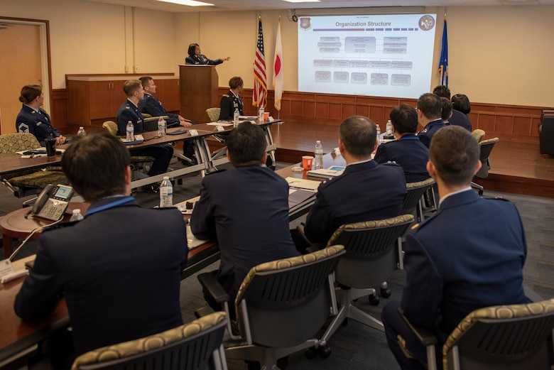 U.S. Air Force Col. Iris Reedom, United States Forces Japan Surgeon General and 374th Medical Group commander, provides a brief rundown of the organizational structure to Japanese Air Self-Defense Force Maj. Gen. Shinya Bekku, JASDF Surgeon General, and his staff at Yokota Air Base, Japan, Oct. 28, 2019.