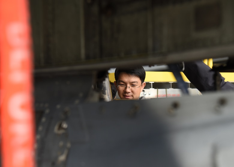A member of the Republic of Korea Air Force legal team looks at an A-10 Thunderbolt II assigned to the 25th Fighter Squadron at Osan Air Base, ROK, during a Friendship Day with U.S. Air Force legal teams from Osan and Kunsan Air Bases, ROK, October 23, 2019. The purpose of the day was to give both counterparts the opportunity to spend time together and strengthen the ties between the two nations. (U.S. Air Force photo by Senior Airman Denise M. Jenson)