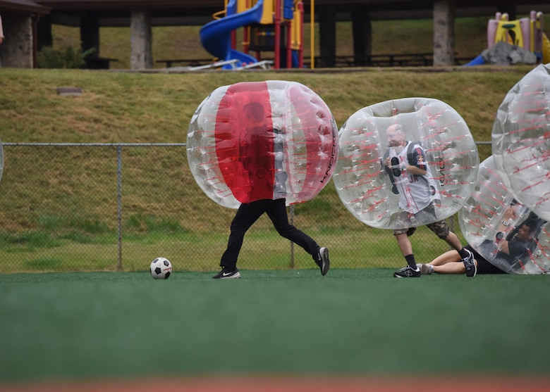 Members of the U.S. and Republic of Korea Air Forces legal teams play a game of bubble soccer during a Friendship Day at Osan Air Base, ROK, October 23, 2019. The purpose of the day was to give both counterparts the opportunity to spend time together and strengthen the ties between the two nations. (U.S. Air Force photo by Senior Airman Denise M. Jenson)