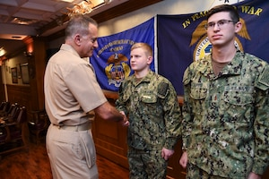 191023-N-KZ419-1035 NAVAL SUPPORT ACTIVITY BAHRAIN, Bahrain (Oct. 23, 2019) Rear Adm. Jack Buono, Superintendent of the U.S. Merchant Marine Academy, pins Ensign Daniel May with his Strategic Sealift Officer Warfare Insignia during after a tour of the Naval Coordination and Guidance for Shipping (NCAGS) facilities. The U.S. Naval Forces Central Command (NAVCENT) NCAGS team has recently amplified their support to the region in support of Operation Sentinel, a multinational maritime security effort designed to increase surveillance of key waterways in the Middle East to ensure freedom of navigation. (U.S. Navy photo by Mass Communication Specialist 3rd Class Dawson Roth/Released)