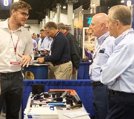 Alec Fixl, far left, DLA Troop Support Industrial Hardware employee speaks to vendors at the Design-2-Part Show Oct. 23-24 in Oaks, Pennsylvania.