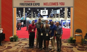 DLA Troop Support Industrial Hardware employees pose for a photo Sept. 29, 2019 at the entrance to the International Fastener Expo in Las Vegas, Nevada.