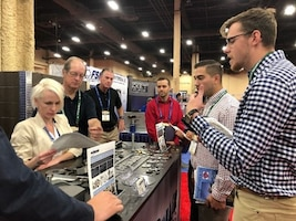 Alec Fixl, far right, DLA Troop Support Industrial Hardware employee speaks to vendors at the International Fastener Expo Sept. 29, 2019 in Las Vegas, Nevada.