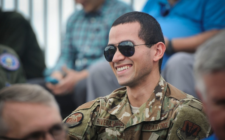 1st Lt. Osvaldo J. Rivera Santos, Air Combat Command Cyber Operations Division deputy flight commander, laughs after a resiliency walk on Joint Base Langley-Eustis, Virginia, Oct. 25, 2019. General Mike Holmes, commander of ACC, led the event to give staff members an opportunity to connect with their coworkers outside of the office. (U.S. Air Force photo by Tech. Sgt. Nick Wilson)