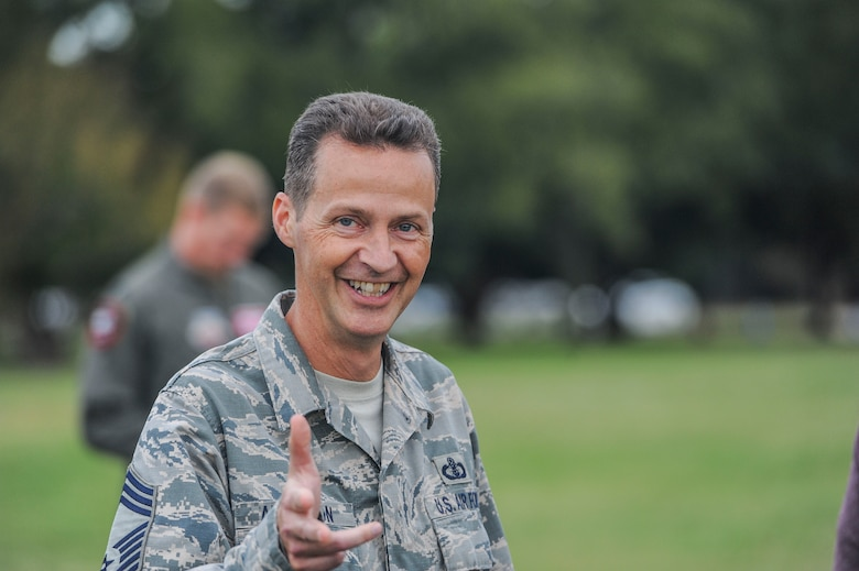 Chief Master Sgt. Charlie Anderson, Air Combat Command Heritage of America Band superintendent, smiles after a resiliency walk on Joint Base Langley-Eustis, Virginia, Oct. 25, 2019. The resiliency walk was organized as part of the commander of ACC's initiative to provide staff members with an opportunity to move, nourish refresh and connect during the duty day. (U.S. Air Force photo by Tech. Sgt. Nick Wilson)